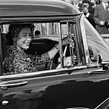 Queen Elizabeth II drives to a polo match in 1958