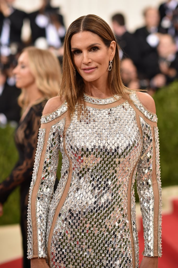 The red carpet got a whole lot hotter when Cindy Crawford arrived at the Met Gala in 2016. On top of showing off her gorgeous figure in a stunning silver Balmain gown, the mother of two proved that age is just a number as she served a heavy dose of sexy while posing for photos with Kendall Jenner and Balmain designer Olivier Rousteing. While it's hard to believe the former model is 50 years old, one thing is for sure: Cindy's still got it. Keep reading to see more of her night, and then take a look at even more star-studded arrivals.