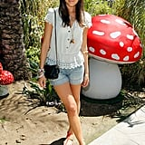 Camilla Belle stepped out in an eyelet-trimmed top and denim shorts for Mulberry's afternoon fête.
