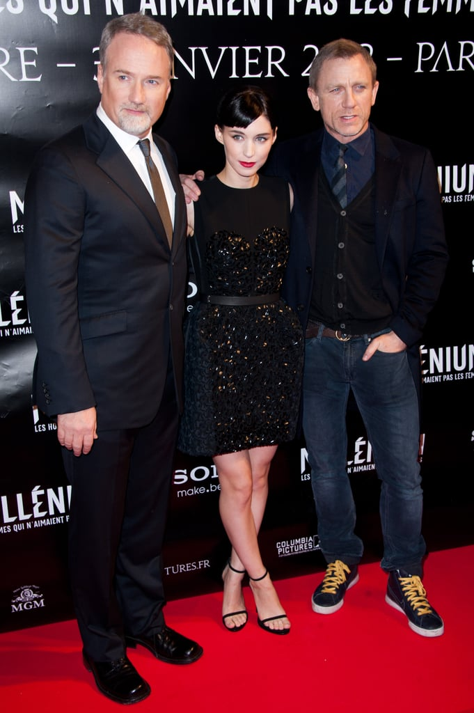 Rooney Mara and Daniel Craig welcomed the new year with a red-carpet appearance for The Girl With the Dragon Tattoo in Paris today. The costars kicked off promotions for the film in December ahead of its midmonth release in the US. The dramatic movie had a solid opening at the box office, coming in just behind Mission: Impossible — Ghost Protocol and Sherlock Holmes: A Game of Shadows. Daniel brought his wife, Rachel Weisz, along to France, though she didn't join him in front of the cameras. He was dressed down in jeans for the event, but Rooney wore a black Louis Vuitton number. Daniel looked similarly casual in his Vanity Fair spread with Matt Damon and George Clooney, which highlighted the actors and their latest big-screen hits.