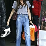 Most recently, during a family outing in Paris in May, Victoria Beckham made quite a chic impact in light-wash wide-leg Chloé jeans ($595) with a dramatic high waist. We especially adore the double-braid detail and tiny pockets. A dark red chain-handle bag worked incredibly well with her color scheme.