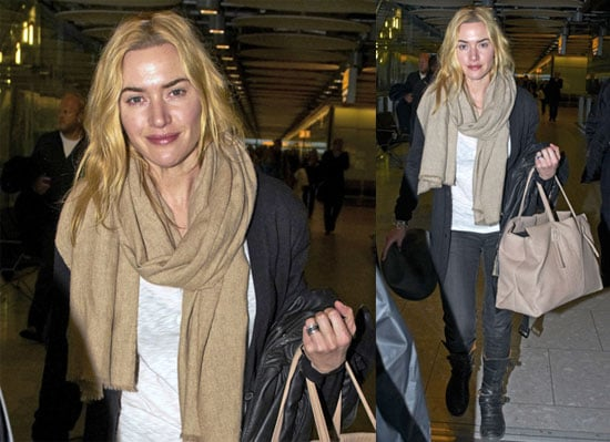 Photos of Kate Winslet Arriving at Heathrow Airport Wearing Jeans and a Large Cozy Scarf