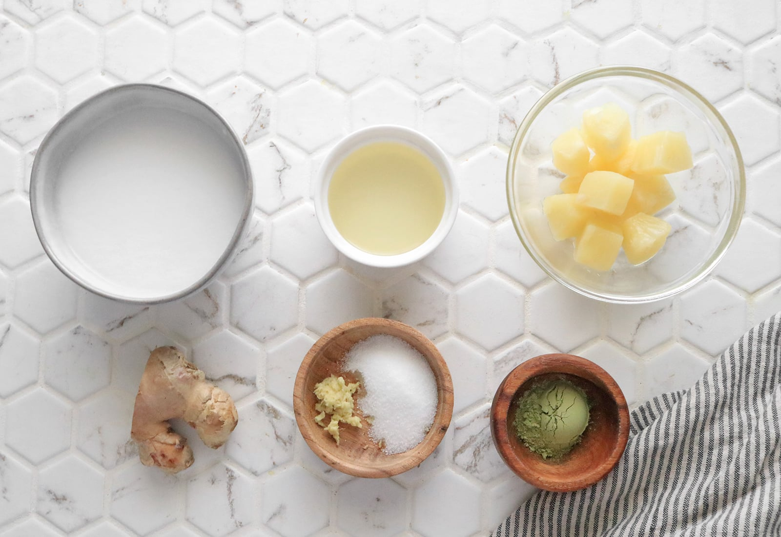 Ingredients for iced pineapple matcha latte