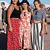 Don't let these looks deceive you. These three pals all opted for ultra-wide-legged pants, not skirts or dresses, when putting together their festival looks.