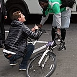Michael Fassbender stopped to autograph a fan's bike in NYC.