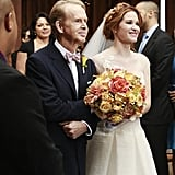 April's father walks her down the aisle.