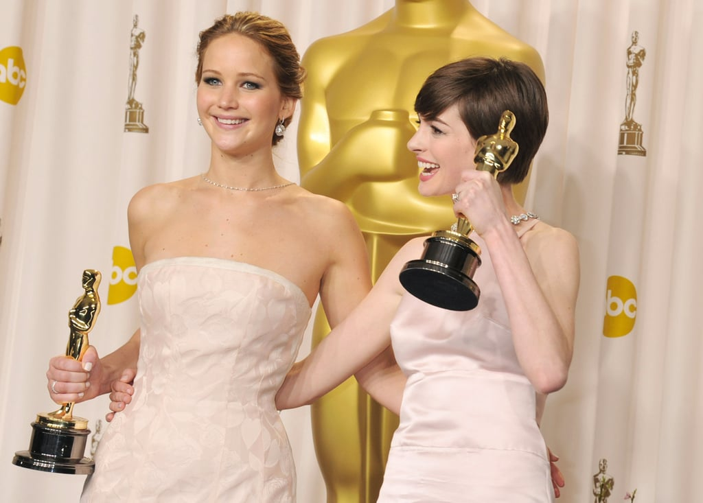 Jennifer Lawrence and Anne Hathaway celebrated their wins backstage at the Oscars 2013.