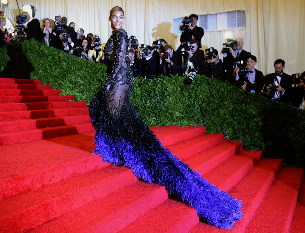 Another shot of Beyoncé's Givenchy gown at the 2012 Met Gala, feather train and all.