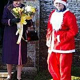 Queen Elizabeth II received some flowers from someone dressed as Santa Claus in 2004.