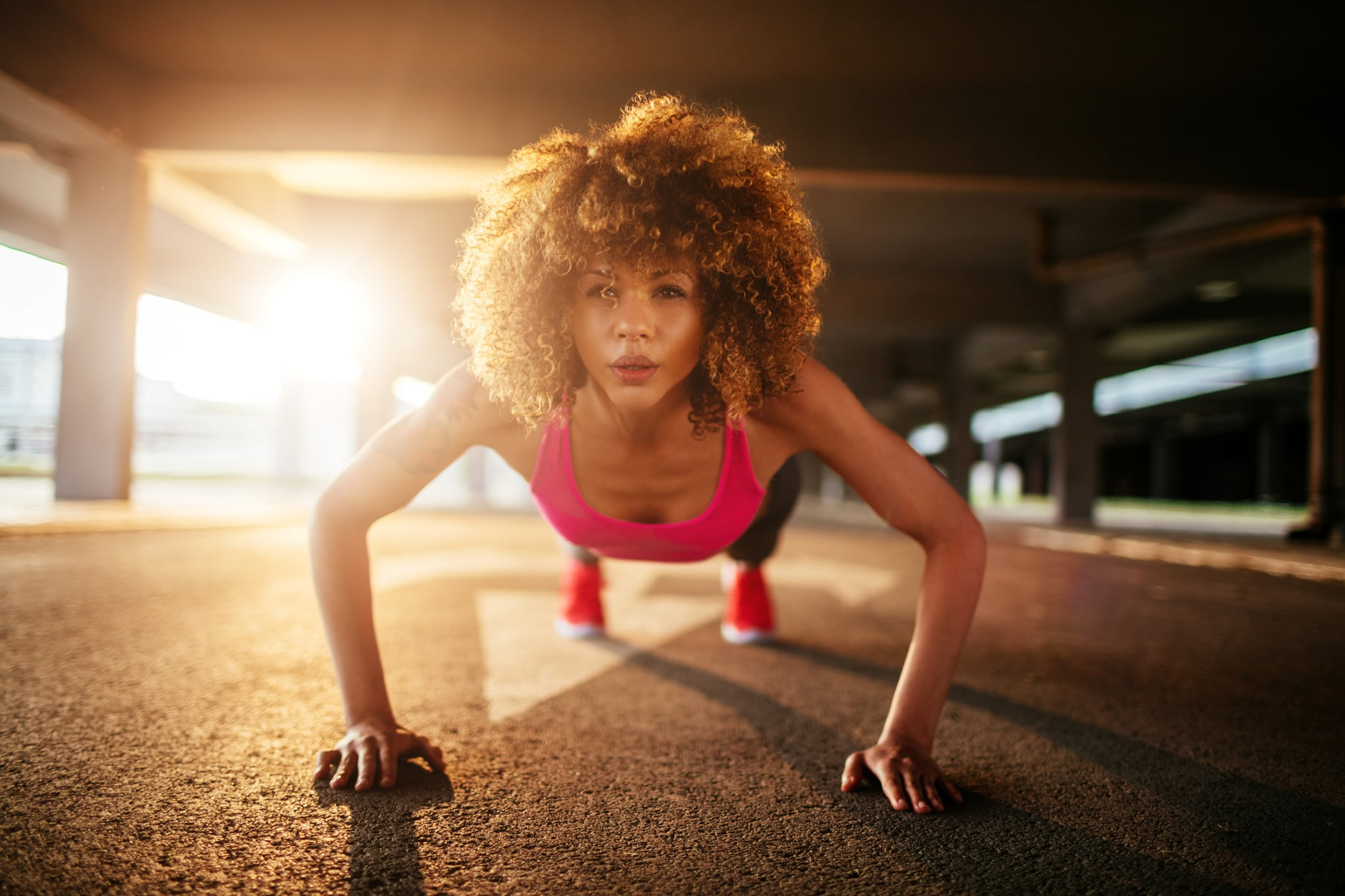 Close up of a young woman doing push ups