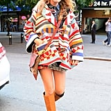 Blake stepped out in New York City wearing a Lindsey Thornburg geometric print coat, a Sam & Lavi skirt, a Sandast crossbody bag, and neutral knee-high boots, proving her layering game is right on-point for Fall.