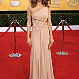 Hilary Swank nailed the nude trend in a one shoulder Versace dress.