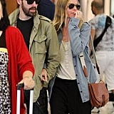 Kate Bosworth and Michael Polish headed through the airport.