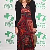 Angela Lindvall opted for a more bohemian look in a scarf-printed maxi dress.