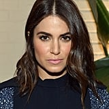 Nikki Reed went for her signature look with a middle part, bold brows, and a natural makeup palette with a pop of pink on her lips.