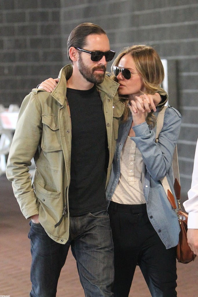 Kate Bosworth and Michael Polish walked through the airport together.