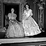 "They posed in elaborate dresses for a Christmas pantomime performance of ""Old Mother Red Riding Boots"" in 1944."