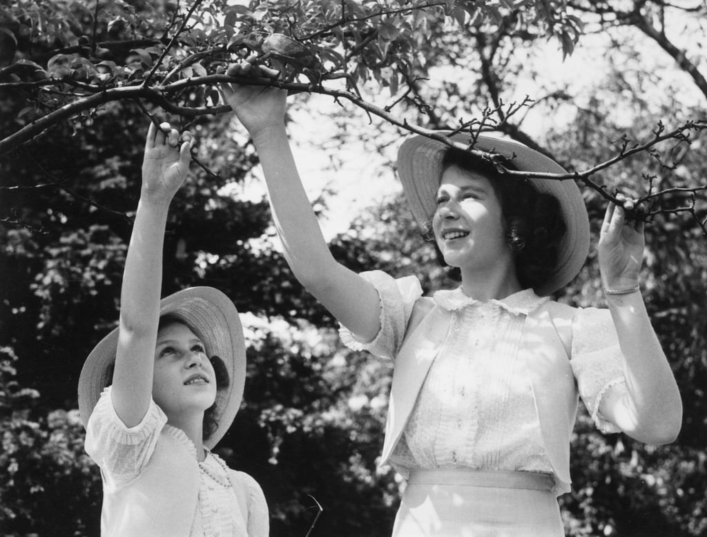 Princess Margaret Rose and then-Princess Elizabeth played with their pet chameleon in July 1941.