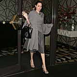 Angelina styled her Michael Kors Collection wrap with a sophisticated dress from the same label and neutral accessories.