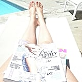 CelebStyle enjoyed some poolside reading.