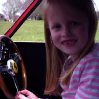 7-Year-Old Drives Red Ferrari