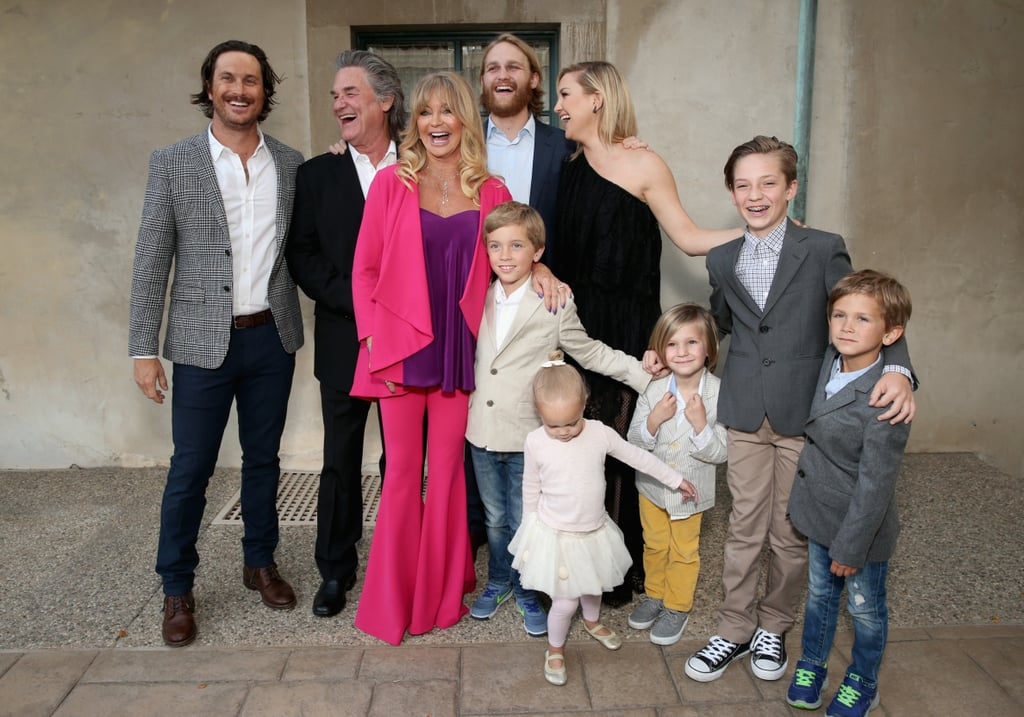 """Goldie Hawn has quite the good-looking family! On Friday night, the actress hosted her annual Love In For Kids benefit in Beverly Hills, CA, and had the support of her entire brood. Goldie beamed with happiness as she hit the red carpet with her other half, Kurt Russell, daughter Kate Hudson, and her two sons, Oliver Hudson and Wyatt Russell. Also with them were Kate's sons, Ryder Robinson and Bingham Bellamy, as well as Oliver's children, Bodhi, Rio, and Wilder Hudson.  At the soirée, Goldie revealed her Mother's Day plans, telling People, """"We're going to Kate's. Everybody's kids will make things, and all the guys will be there, and then we'll all get in bed and eat."""" Most recently, Kate attended a screening of her latest film, Mother's Day, giving off major Goldie vibes. Keep reading to see more photos from the event, and then in honor of Mother's Day on Sunday, look back at the sweetest things Kate has said about her famous mom."""