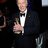 Christopher Plummer clutched his best supporting actor statue.