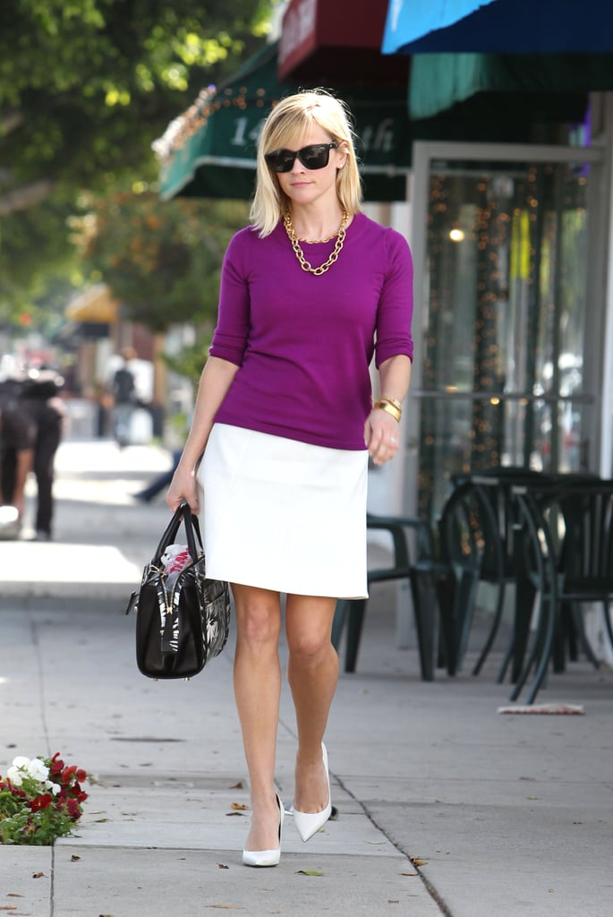 Reese was ready for Spring in a regal sweater, white mini, and coordinating pumps in LA.