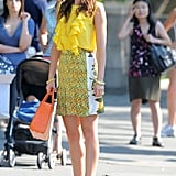 Leighton Meester wore a sunny yellow ensemble from Stella McCartney, Brian Atwood pumps, and an orange Riki Rosetta tote.
