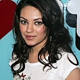 A youthful Mila stuck to a pretty and fresh-faced look at a 2005 appearance on TRL. She kept her chestnut-brown hair loose and wavy.