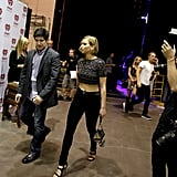 Jennifer Lawrence walked backstage at the iHeartRadio music festival on Friday — see her rumoured beau Chris Martin in the background there?