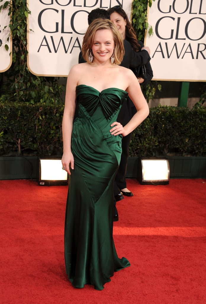 Elisabeth Moss chose a gorgeous green custom Donna Karan gown for the Golden Globes in LA yesterday evening. She was nominated for best actress, and the drama is also up for best TV series. Keep up with all the hottest looks in fashion and beauty from the red carpet with Fab and Bella's love it or hate it polls!