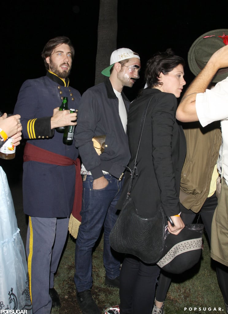 Rob and Kristen Wear Masks For a Hollywood Halloween Bash