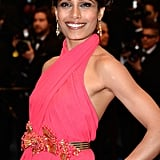 Freida Pinto was a vision in bright pink wearing a stunning Gucci gown. She wore a crown of braids on her head and kept her makeup simple but glowing. L'Oreal True Match Lumi Foundation ($11) was used to create a flawless base. Then, her eyes were given a bronzed smoky treatment with Colour Riche Eye Shadow Quad in Because I'm Worth It ($8); lips where enhanced with Infallible Le Rouge in Tender Berry ($10).