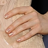 Actress Andrea Riseborough wore a gold glitter top coat over her nails for a subtle hint of sheen and sparkle.