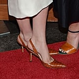 Ashley kept her feet classic via pointy slingback crocodile Manolo Blahnik pumps. For a similarly ladylike feel, get these lambskin slingback pumps from Brooks Brothers ($198) and wear them with your longer hemlines.