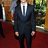 Taylor Lautner arrived in a suit.