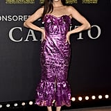 Wearing a purple strapless dress by Francesco Scognamiglio with silver platform pumps at the Pitch Perfect 3 premiere in December 2017.