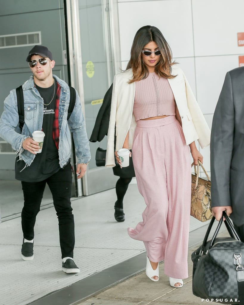 Nick Jonas and Priyanka Chopra are taking their newfound romance to the Big Apple! On Friday, the couple touched down together at JFK Airport in NYC. While the couple steered clear of any PDA, Priyanka looked gorgeous in a beautiful pink ensemble and Nick kept things casual in a denim jacket and sunglasses.  Reports of a romance between Nick and Priyanka first surfaced last month after the two spent Memorial Day weekend together. Even though Nick and Priyanka have yet to publicly confirm the status of their relationship, their date nights and flirty comments on Instagram pretty much speak for themselves.        Related:                                                                                                           SOS: We Can't Stop Drooling Over These Shirtless Nick Jonas Photos, and Neither Will You