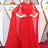 Wearing a Giambattista Valli gown with a cape at the 2018 Oscars.