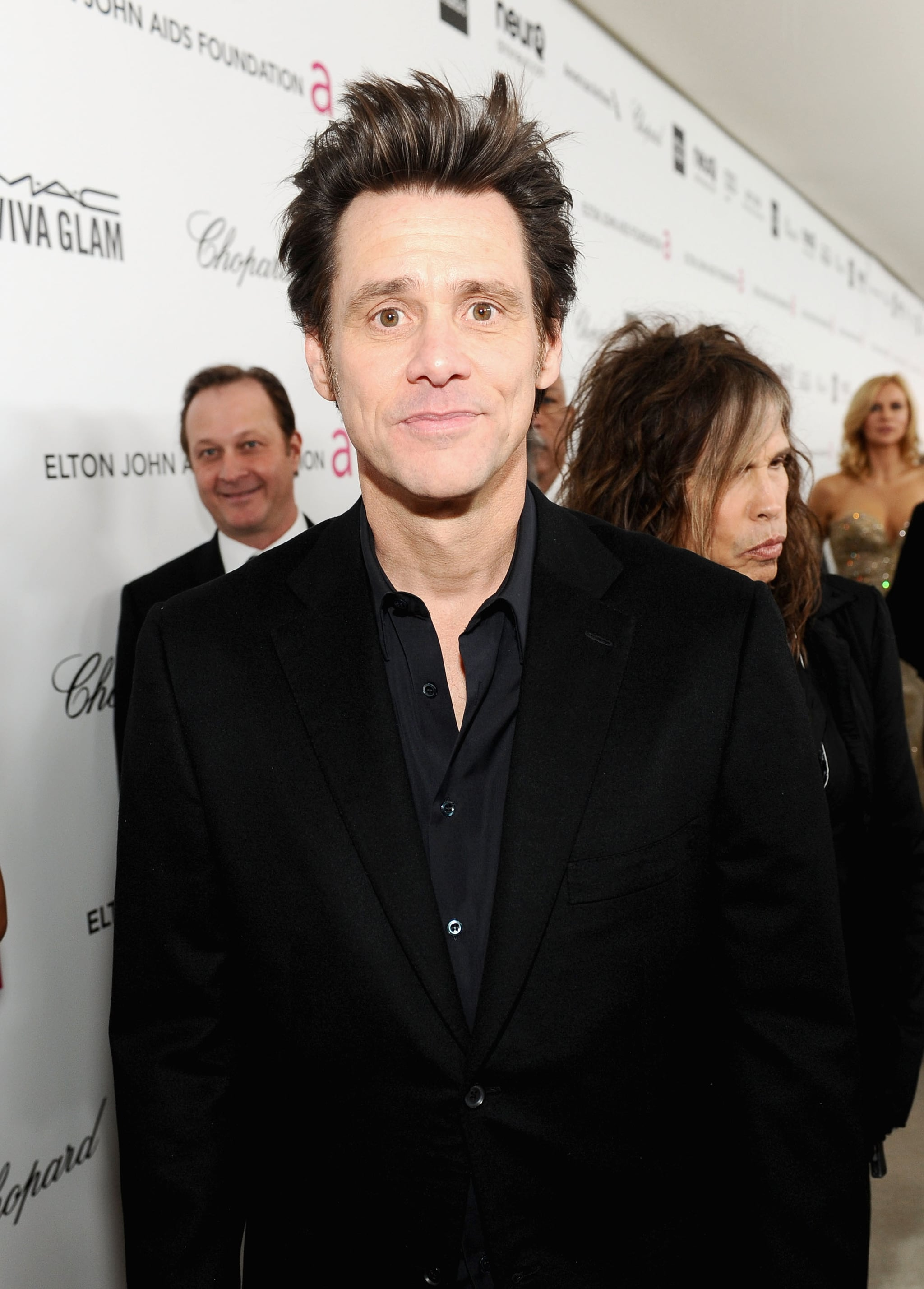 Jim Carrey smiled on his way into Elton John's Oscar party in LA.