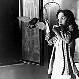 In Suspiria, Susie has to fend off the same animal, only she takes it out with a stool.