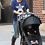 Kate Hudson took a family stroll in NYC wearing this 291 love sweater ($178), a studded bag, Ray-Ban aviators, and a couple gold necklaces.