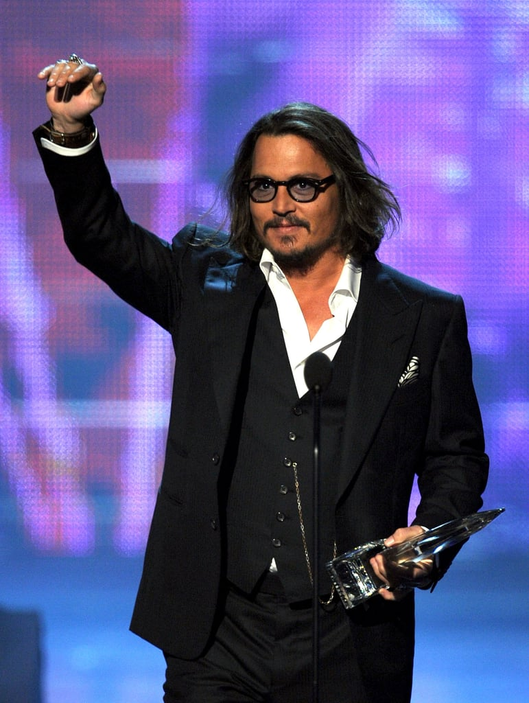 Johnny Depp graciously accepted the award for favourite male movie star at the People's Choice Awards in LA last night. He's a frequent winner in the category, though Twilight fans were still surprised to see Johnny come out on top of Robert Pattinson. Taylor Swift presented the statue to sexy Johnny, and he sweetly passed on a hello to the country star from his daughter, who is apparently a huge fan. Johnny is also up for a Golden Globe for his work in The Tourist, so perhaps this is only the beginning of his award season success. Weigh in on all the night's fashion with Fab and Bella's live love it or hate it polls!