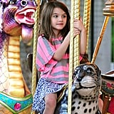 Suri Cruise took a turn around the Schenley Plaza carousel on a leopard seal.