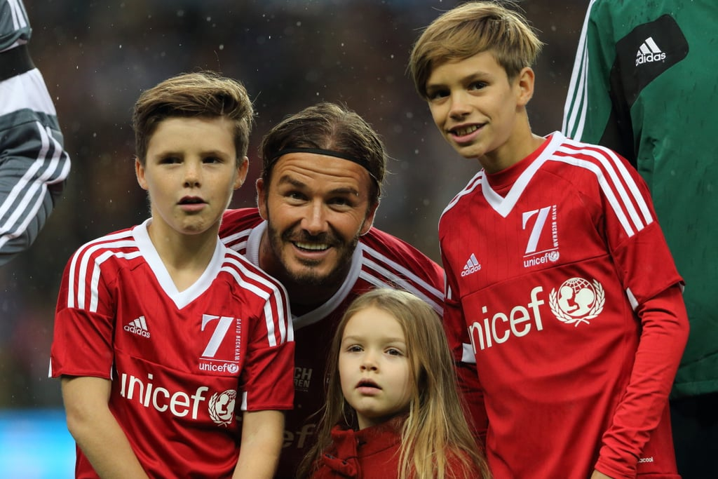 "It was a family affair at the UNICEF football charity match between Great Britain and Ireland at the Old Trafford field in Manchester on Saturday. David returned to the field for the last of his seven matches in seven continents and had the support of his adorable children, Brooklyn, Cruz, Romeo, and Harper. At one point, his eldest son, Brooklyn, joined David on the field and played alongside the former football star. The event was organised by UNICEF, for which David is an ambassador, and benefited the charity's work to provide life-saving care for children.  Before the match, David took to Instagram and shared a photo of himself and Brooklyn, writing, ""Look who came to have pre match meal with his dad .... One of my lasting memories was walking this little boy around Old Trafford age just 18 months.... Good to be home,"" adding to their long list of sweet moments together. Keep reading to see more cute moments from the brood's day, and then check out the very permanent way that David recently honoured his family."