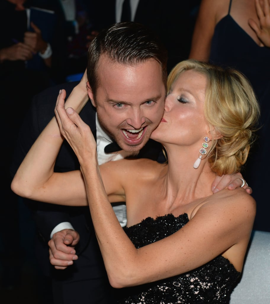 Anna Gunn planted a kiss on Aaron Paul's cheek.