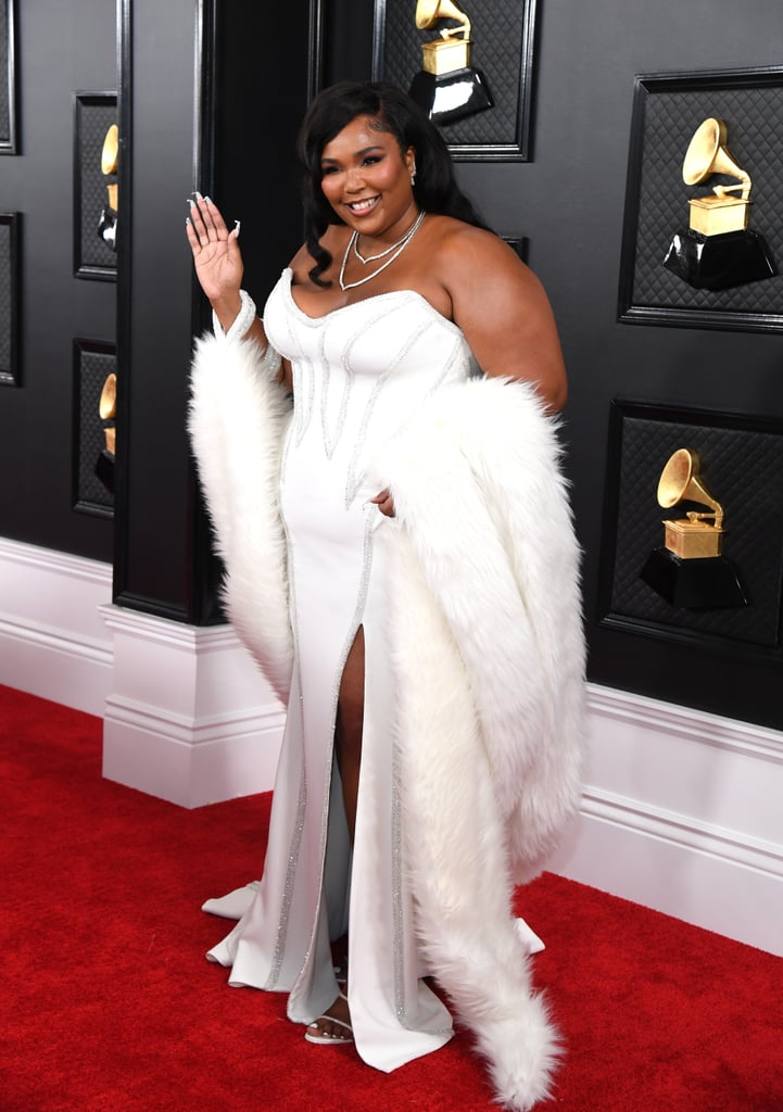 "Lizzo made a truly dazzling appearance at Sunday's  Grammys in Los Angeles. The 31-year-old singer stepped out and turned heads as she rocked a Diana Ross-inspired white Versace gown with silver details and a sexy slit. She complemented the look with a fur wrap and accessorized with a layered necklace and a simple ring.  It was a memorable evening for the songstress, who received seven nominations. While her chart-topper ""Truth Hurts"" earned nods as record of the year, song of the year, and best pop solo performance, her LP Cuz I Love You was a contender for album of the year, and the deluxe edition received a mention in the best urban contemporary album category. She's also in the running for best new artist, and her song ""Exactly How I Feel"" with Gucci Mane is a potential recipient of the best R&B performance award. Keep scrolling to see all the photos from her glamorous night out!"