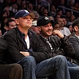 With Leonardo DiCaprio at a Lakers game in 2011.