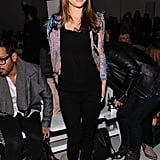 Natalie Portman finished her all-black ensemble with a Rodarte cardigan at the Fall '12 show.